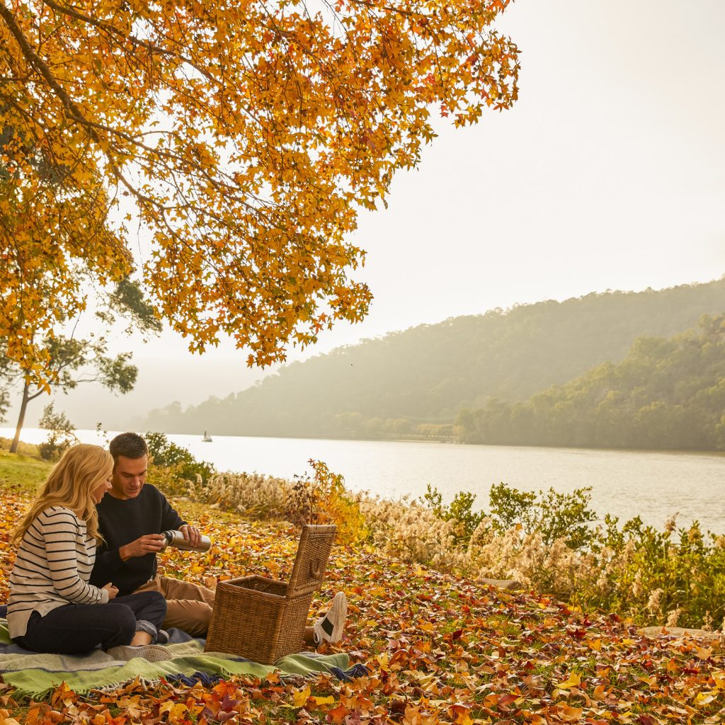 Couple enjoying a romantic picnic by Hawkesbury River near Wisemans Ferry.